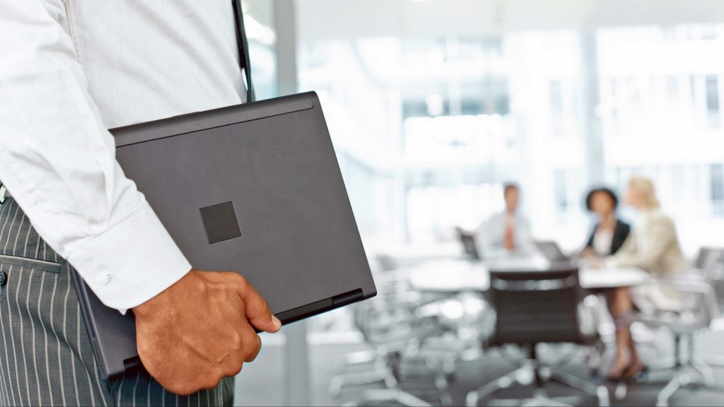 A Corporate Service Man holding his business files
